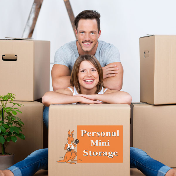 Couple with Personal Mini Storage boxes