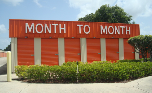 Month to month storage rental sign on a building