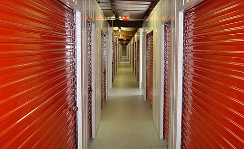 Long air conditioned hallway with various sized storage spaces