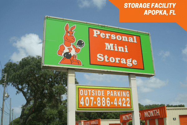 Personal Mini Storage Apopka signage featuring outside parking
