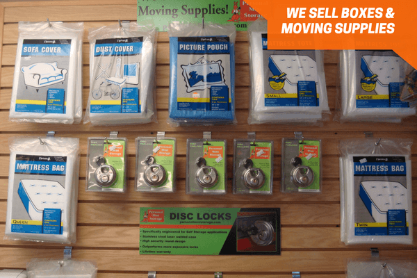 Wall of packing supplies and locks for sale