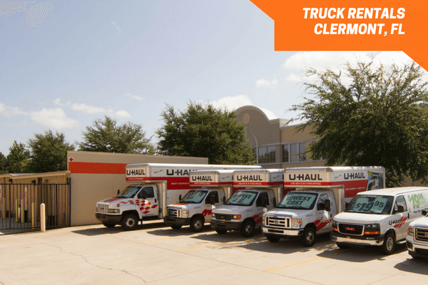 U-Haul moving trucks parked in a line